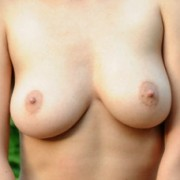 Busty Beauty Susi Stripping by a Stream