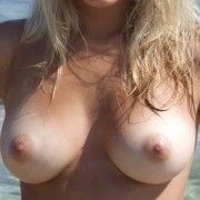 Natalie - Cute and Busty on the Beach