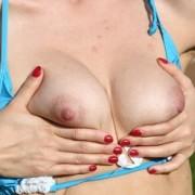 Brunette Felicia Sunbathing and Stripping